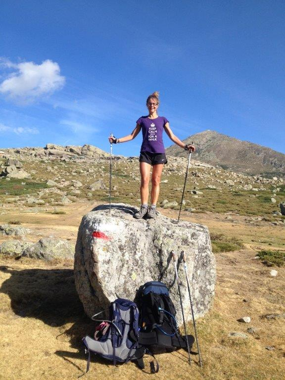 Hilary Warrell on a rock while Nordic Walking